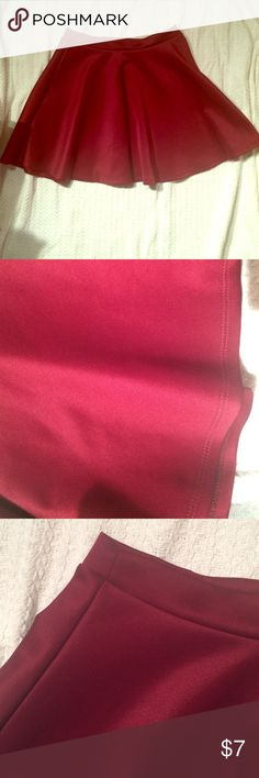 A burgundy skater skirt A burgundy skater skirt made up of a polyester and spandex combo giving it a unique touch and texture. Great for dressy and causal events; mainly during the autumn and winter. Popular Basics Skirts Midi