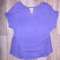 Eyelash Couture purple V neck T shirt with lace Eyelash Couture brand purple V neck T shirt with lace sides.  Shoulders have slits which is a cute feature. Fits a little flowy. Self: 100% rayon, Contrast: 60% cotton, 40% nylon. Tops Tees - Short Sleeve