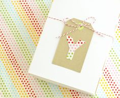 #DIY Fabric Letter Tags, which would go perfectly on holiday presents, from @Jordan Ferney | Oh Happy Day!. A creative way to use fabric scraps and to make presents or gift bags look super cute! /ES