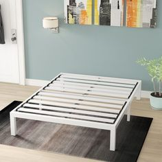When it comes to setting up a restful retreat that will lull you into sweet dreams, it all starts with a good bed. A bed like this, for example, is a great option for lending any space an understated contemporary look. Crafted from steel with a white finish, this platform bed includes a slat kit, so there's no need to add a box spring: just place your mattress directly on the frame! This piece is also backed by a five-year warranty. Bed Frame Sizes, King Size Bed Frame, Steel Bed Frame, Metal Platform Bed, Bed Slats, Panel Headboard, Mattress Springs, Under Bed Storage, Adjustable Beds