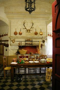 Château de Brissac - Kitchen.  Well if I must live in a Chateau, it must have a kitchen like this.