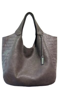 """Free shipping and returns on Urban Originals 'Masterpiece' Croc Embossed Tote at Nordstrom.com. Croc-embossed side panels define a slouchy tote constructed from soft faux leather . Large enough to fit your favorite tablet or a 15"""" laptop, it also features a clever pocket inside that keeps your smartphone safely tucked away."""