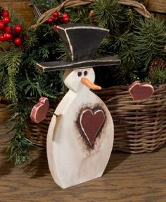 Heart Snowman home decor hand crafted out of wood on Etsy, $16.00
