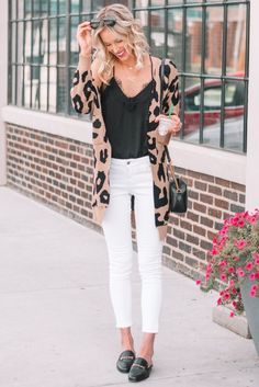 how to wear a leopard cardigan for fall, leopard, white jeans, black lace cami #leopard #leopardcardigan #whitejeans #blackslides #blackshoes #mules