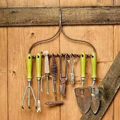 Saw this on This Old House | Repurpose an old rake head to organize garden tools.