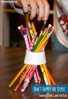 A fine motor game for Thanksgiving that will have kids trying to keep their teepee standing!