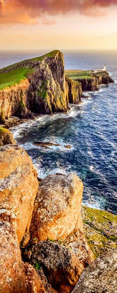 Vertical view of Neist Point lighthouse with rocks in foreground and rocky coastline, Scotland | 19 Reasons Why Scotland Must Be on Your Bucket List. Amazing no. #12
