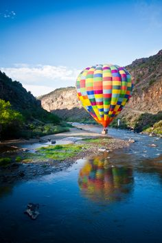 Hot air balloon skimming Rio Grande River - New Mexico