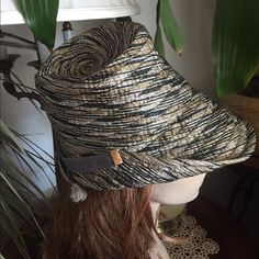 "Vintage 60's Schiaparelli Hat ~ PARIS Highly stylish 60's ""Schiaparelli Paris"" tricolored gray~ camel ~ white swirl design fabric dress hat. Side & back flip up & back has accent gray & camel grosgrain ribbon band w/eyelash fringed ends. Inside lined in gray grosgrain ribbon. In excellent preowned vintage condition. Smoke-free home. Mannequin for display only & not reflective of how your hat will fit. Please measure your head before ordering. - Inside circumference 21-1/2"" - Outside diameter…"