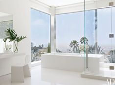 Inside a James Magni–designed Beverly Hills home, varieties of white quartz-based tile sheathe the master bath; the chair is by Peter Karpf. Decorating with white Quartz. Architectural Digest, Bathroom Interior Design, Modern Interior Design, Interior Design Inspiration, Design Ideas, Beautiful Bathrooms, Modern Bathroom, Small Bathroom, Master Bathroom
