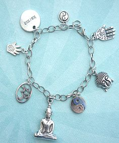 this charm bracelet features meditation inspired tibetan silver charms (nickel free). the charms are attached to a silver tone 7.5 inches chain bracelet.