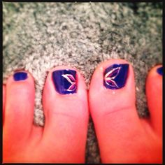 Blue nails with silver wings and purple accent - nail art!