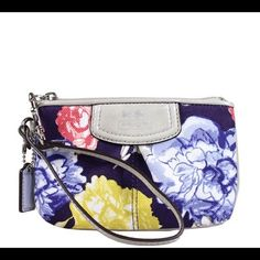 """HOST PICK!! SALE!!! NWT Coach floral wristlet!!! HOST PICK!!! SALE!!! NWT Coach gorgeous floral wristlet!!!  Measures 6 1/2"""" in length & 4"""" in height Coach Bags"""