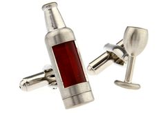 With a glass on one hand, and a bottle of red on the other, you'll love wearing these novelty cufflinks. Created in polished rhodium with a red enamel inlay, these novelty cufflinks are simply stunning. There's nothing like a glass of red after a hard day at the office and these stunning wine bottle and glass cufflinks will help you get through even the roughest day. You won't get called an alcoholic if you bring this wine glass and bottle to work either.