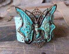 Turquoise Butterfly Leather Cuff (one left in stock) ~ Made with a vintage leather belt, hand painted and embellished with a stunning brass butterfly that was aged with a verdigris patina. #bohochic