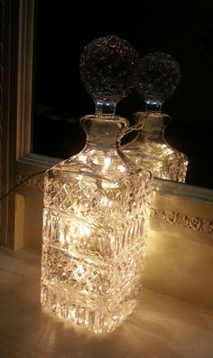 Upcycled Charity Shop decanter filled with LED lights. Perfect in front of my hall mirror.