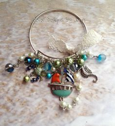 March 2015 Challenge .. Adventures In The Sea Bangle Charm Bracelet .. Jann Tague .. Clever Designs .. https://www.facebook.com/JewelsByJann