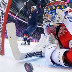 TJ Oshie's winning goal in the USA vs Russia hockey after the 8 round shoot out. This photo is unreal. Bruce Bennett/AP