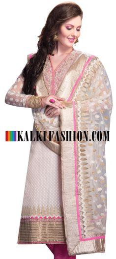 Buy Online from the link below. We ship worldwide (Free Shipping over US$100)  http://www.kalkifashion.com/semi-stitched-suit-featuring-in-off-white-chanderi-cotton-neckline-is-enhanced-in-zardosi-and-kundan-embroidery-churidar-is-of-pink-silk-fabric-length-is-50-95-of-our-customers-believe-that-the-product-is-as-shown-on-the-website.html