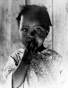 Dorothea Lange, 1937, Ellis County, Texas. Child of former tenant farmer, now a day laborer.