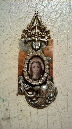 Pendant with soldered filigree and resin bezel