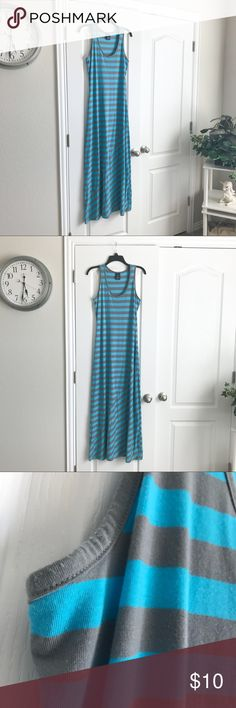 Gray & Blue Striped Maxi Pre-loved and in good condition. Minor signs of wear but no stains, snags, or tears.    PRODUCT DETAILS: •Size: Large ( 12 - 14 ) •Colors: Gray, Blue •Made in Cambodia •Measurements: Chest-17inch Length-56inch •65% polyester, 35% rayon •Machine Wash •Sleeveless •Horizontal strip print •Scoop Neck •Diagonal stitch Down Skirt  •Great summer basic!   Tags: beach pool cover up long floor length swim bathing suit casual aqua fun Simple Everyday Faded Glory Dresses Maxi