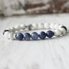 A unsex healing bracelet made with white howlite and sodalite. Handcrafted with love and intention in the U.S.A. Carefully strung on latex-free elastic cord to make it easier putting on and taking off