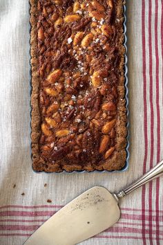 The gooey filling in this tart is held together by a rye flour crust that gets its structure, and depth, from chocolate.
