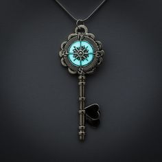 Glowing heart key with compass