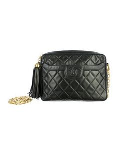 Chanel Vintage Camera Quilted Classic Timeless Jumbo Lambskin Leather Large Cc Logo Tassel Bijoux Chain Link Gold Hardware Black Cross Body Bag. Get the trendiest Cross Body Bag of the season! The Chanel Vintage Camera Quilted Classic Timeless Jumbo Lambskin Leather Large Cc Logo Tassel Bijoux Chain Link Gold Hardware Black Cross Body Bag is a top 10 member favorite on Tradesy. Save on yours before they are sold out!