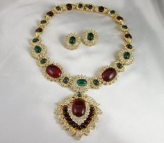 From the Estate of Jacqueline Kennedy Onassis: a cabochon colored stone and diamond pendant necklace by Van Cleef & Arpels.