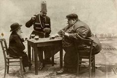 History In Pictures @HistoryInPix A French postcard with the tallest, shortest, and fattest men of Europe playing a game of cards, circa 1913