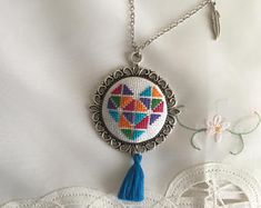 Cross stitch necklace with detailed heart shape. Free shipping US only.