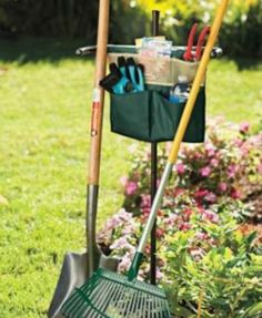 """OUTDOOR GARDEN TOOL STAND . $19.99. No more throwing your garden tools and shovels on the ground. Hoes, rakes and shovels can be leaned upright for easy access. A must have for the gardening enthusiast. 45"""" stake with canvas storage pouches. Save your back and your time. Just stake the garden tool stand into the ground and lean shovels, hoes and rakes upright for easy access. Features canvas pouch that attaches to the handlebar to hold seed packets and smaller han..."""