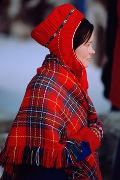 Sami girl in traditional hat and shawl. Jokkmokk Winter Market, Sweden.: Sami, Jokkmokk Market: Arctic & Antarctic photographs, pictures & images from Bryan & Cherry Alexander Photography.
