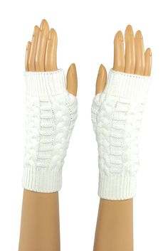White Mid Length Knitted Fingerless Gloves  Stroke me, stroke me! Or so the song goes... And yes, the faux fur on these pups is as soft as it looks. Perfect for brushing that snowflake from your cheek when the rest of your world is making you chapped and raw. #fingerless #fashion #crochet