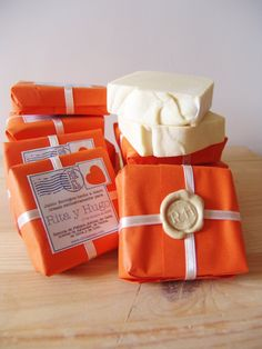 Soaps wrapped like a package with a little soap like wax stamp