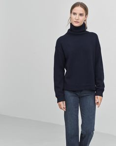 An elegant and luxurious Loose fit roller with a wide collar in 100% recycled cashmere. Shaped bottom that's slightly longer at the back. Vertical seam detail that runs down the center of the back. <br> <br> - Luxe Recycled Cashmere <br> - Shaped bott