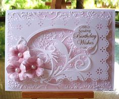 delicate die cuts, brayered embossing, dimensional frame...one sweet card in pink and white...