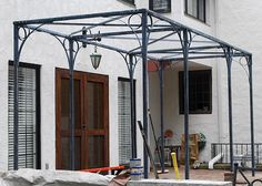 This clean lined steel pergola is made in Michigan by The Branch Studio, which is a sister company to Detroit Garden Works. The pergola is designed and fabricated to be taken apart for delivery or… Vinyl Pergola, Pergola Canopy, Pergola Swing, Outdoor Pergola, Wooden Pergola, Backyard Pergola, Pergola Shade, Pergola Kits, Pergola Ideas
