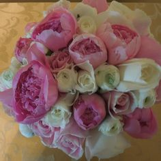 Pink garden roses, white roses, white ranunculus bouquet.