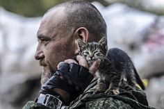 Jul. 22, 2014. A pro-Russia separatist pets a kitten standing on his shoulder as he mans a checkpoint in the northern outskirts of city of Donetsk.