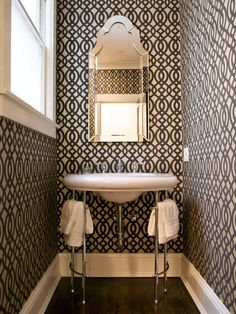 imply adding graphic wallpaper brings dimension to a small powder room. Designer Jennifer Jones enhanced the bold design with a vintage-inspired, decorative mirror. A vintage pedestal sink, which can be found at a flea market, completes the look.