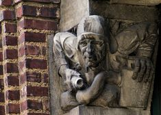 Firefighter gargoyle in Philly, now demolished...