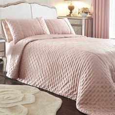 Victoria Blush Bedspread   Our exclusive Victoria range represents the ultimate in femininity and indulgence! The bedspread features a delicate polka dot embroidery that promises to hold the quilt beneath in place. The front is crafted in a silky sateen, while is reverse is a made from a soft microfibre fabric. #Kaleidoscope #Home #Bedroom#Bed #Bloggers #Style #Inspiration www.kaleidoscope.co.uk