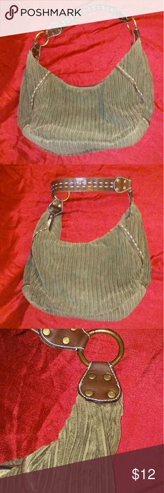 Nine West bag Green corduroy Nine West hippie bag. Metal rings connect the leather handle. Never been used brand new in excellent condition very clean. Inside zipper pocket with one inside open Pocket. Places to put cards and driver's license also on the inside. 14 x 3 1/2 x 8 Nine West Bags Hobos