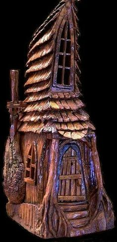 Cottonwood bark house carved by N. Minske.