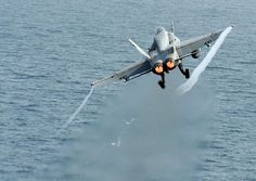 A F/A-18C Hornet assigned to the Blue Blasters of Strike Fighter Squadron (VFA) 34 launches from the flight deck of the Nimitz-class aircraft carrier USS Abraham Lincoln (CVN 72).