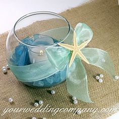 Use this pretty aqua sea glass in wedding reception centerpieces, craft projects or as table confetti.  It is perfect for coastal, nautical and beach-themed weddings. Available at www.yourweddingcompany.com