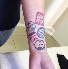 Passport stamp tattoos on wrist by Hayley Brummer